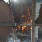 Blick durch die Revisionstüren in den brennenden Filter